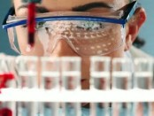 stock-footage-chemistry-student-doing-experiment-in-laboratory-class